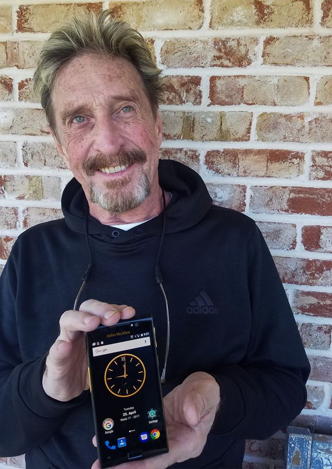 John McAfee with his phone